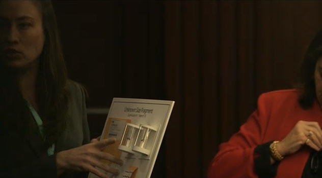 (Maria Pagan shows bullet fragments to jury.)
