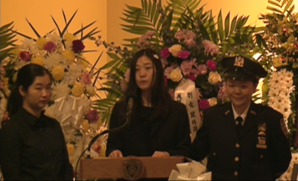 (Wife of NYPD Officer Wenjian Liu at funeral)