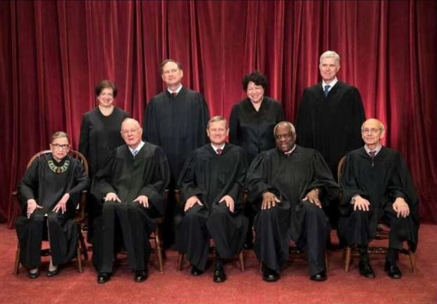 US Supreme Court cancels travel ban hearing, looks at Trump's revised policy